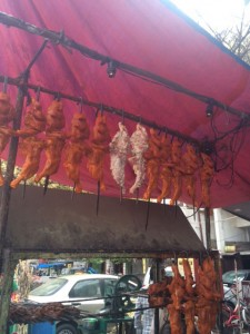 Hanging marinated chicken